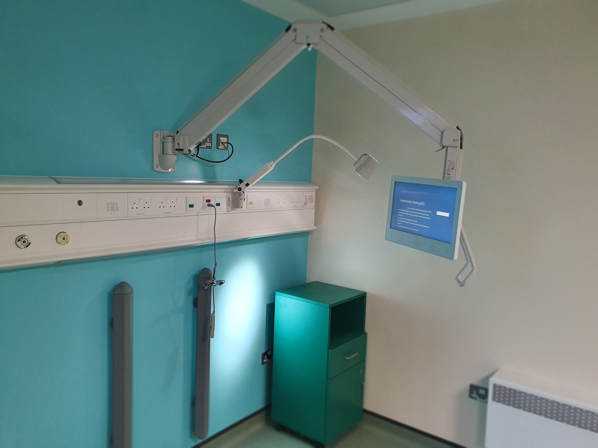 """Phillips Heartline 19"""" patient televisions on Anglepoise Arm Systems."""